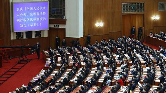 全国人大会议闭幕 高票通过完善香港选举制度决定草案